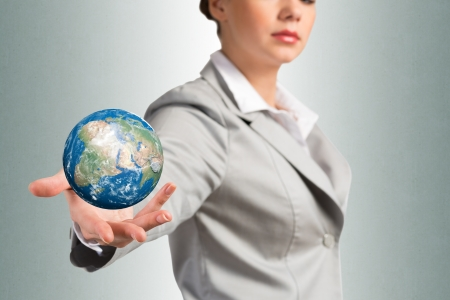 businesswoman holds up a planet Earth    photo