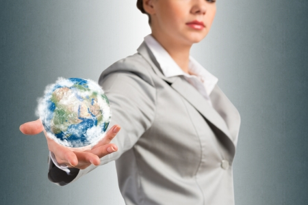 businessman carrying a globe: businesswoman holds up a planet Earth  Elements of this image furnished by NASA