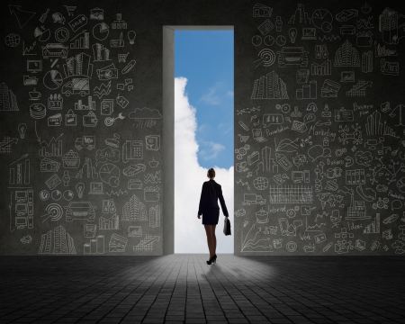 businesswoman standing at the exit, clouds and sky, painted on the wall of a business plan photo