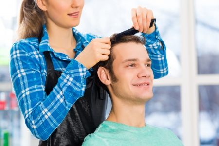 coiffeur: young attractive woman hairdresser hairstyle customer picks Stock Photo