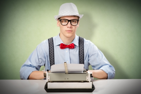 image of a young journalist, sitting at the table for a typewriter photo