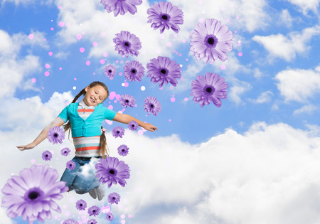 atractive: girl jumping on a background of blue sky and flowers