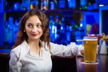 close-up portrait of a young woman in a bar photo