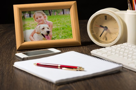 photo frame, mobile phone and notebook with a ballpoint pen  Workplace of the businessman  photo