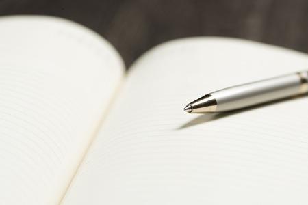 recap: pen and open notepad