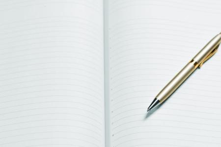 recap: pen and open notepad, business still life