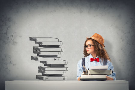 image of a young woman writer at the table with typewriter Stock Photo - 26229621