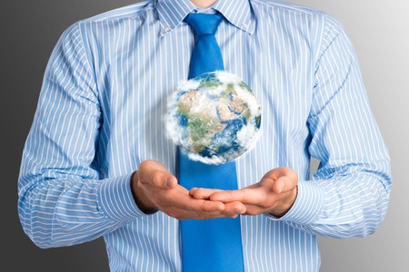businessman carrying a globe: businessman holds up a planet Earth  Elements of this image furnished by NASA Stock Photo