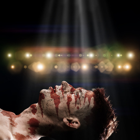 image of a wounded man in blood behind the abstract background photo