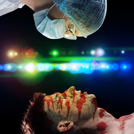 image of a wounded man and the doctor, first aid photo
