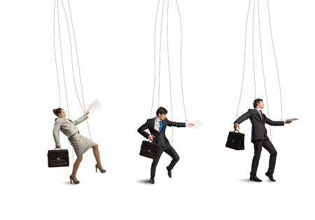 business people puppets hanging by a thread photo