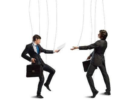 image of a two businessman puppet doll pass each other business papers photo