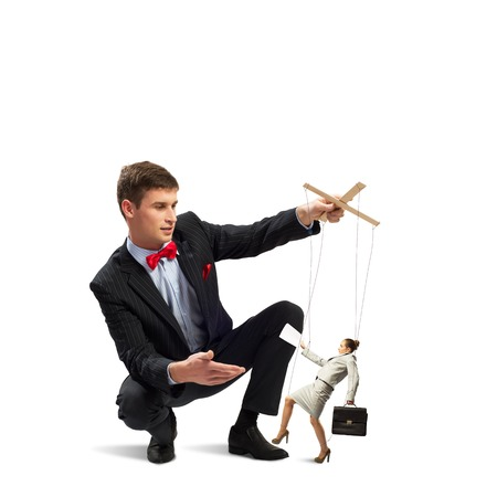 image of a puppeteer holds the puppet business woman photo