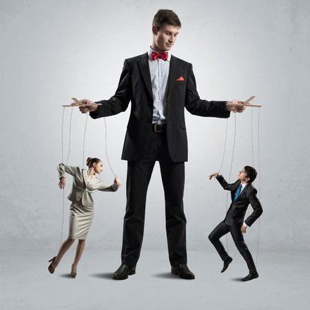 puppeteer keeps business people puppets, concept control business