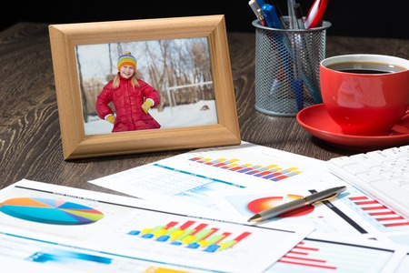 photo frame, business papers with financial charts  Workplace of the businessman  photo