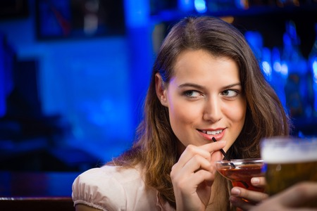 portrait of a young woman in a bar photo
