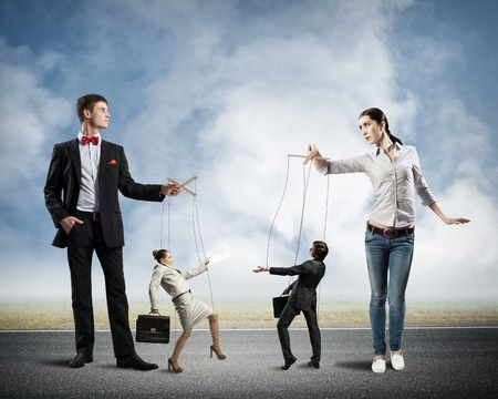 puppeteers holding the strings of puppets business, business concept control photo