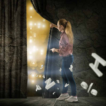 image of a young woman bends curtain fly abstract symbols photo