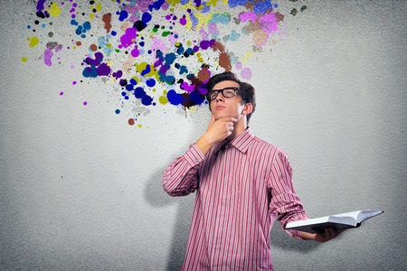 image of a young man with a book, a creative mind Stock Photo