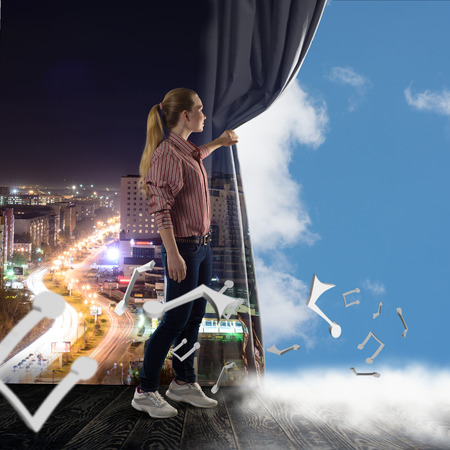 image of a young woman pushes the curtain looking at clouds photo