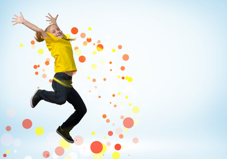 atractive: funny girl jumping around colored dots and rays of light