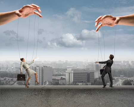 manipulate: puppet dolls business is on the edge, at the bottom of the city from a bird s eye