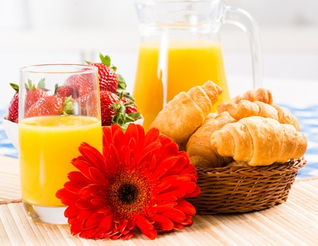 early breakfast, juice, croissants and Berries, still life photo