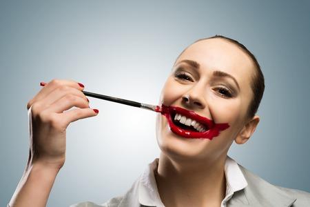鮮やかな赤い口で若い女性のイメージ 写真素材