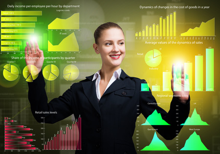 Attractive businesswoman touching icon of media screen photo