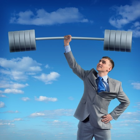 businessman holding a barbell with one hand, the concept of achievements in business photo