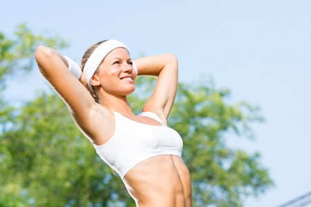 fit woman: Young sport woman enjoying weather in sunny park