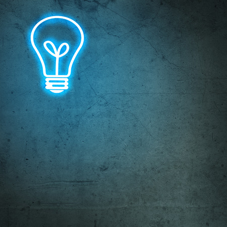 Background image with light bulb on cement wall photo