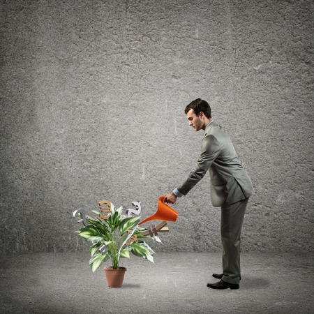 global investing: image of a businessman with a watering can