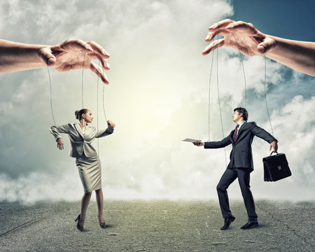 image of a two puppet businessman standing on against each other, concept of business control