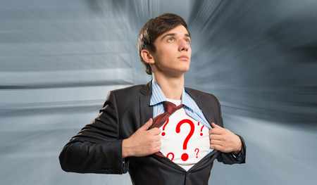 businessman breaks the shirt, under which the question marks behind the abstract background photo