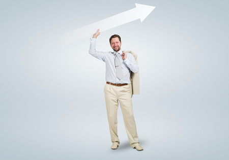 Handsome businessman with white blank arrow. Place for text photo