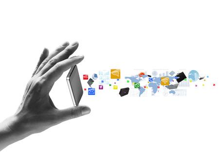 tecnologia: A mão humana que prende o telefone móvel e ícones que voam para fora Banco de Imagens