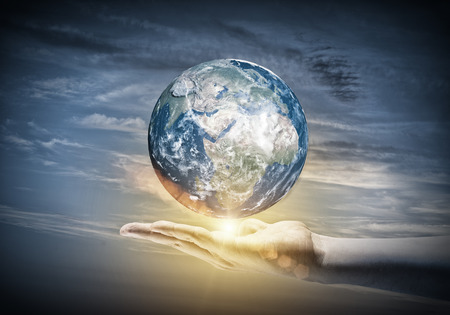 save earth: Human hand holding Earth planet. Elements of this image are furnished Stock Photo