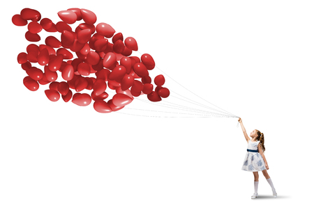 Cute girl of preschool age with bunch of balloons isolated on white photo