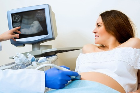 young pregnant woman on the ultrasound, health check