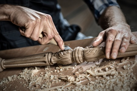 wood cutter: Close up carpenters hands that work with cutter Stock Photo