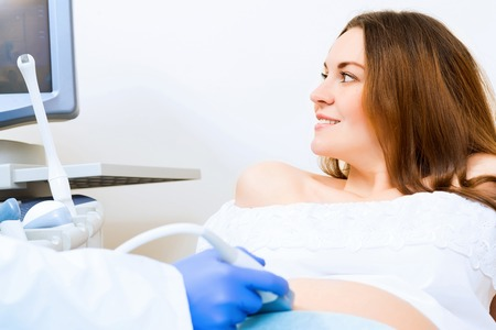 general pediatrician: Young attractive pregnant woman on reception at the doctor, health check