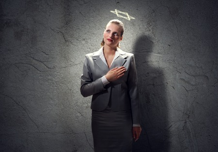 above head: Young saint businesswoman with halo above head Stock Photo