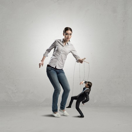 puppeteer controls a businessman holding his strings, the concept of control of business