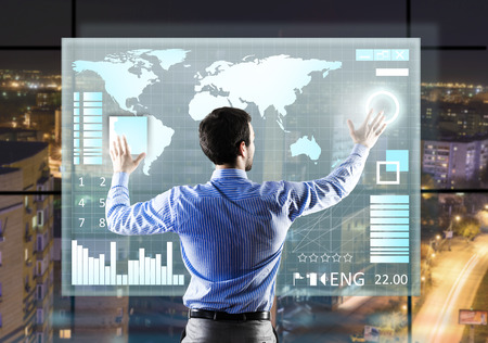 Rear view of businessman touching icon of media screen