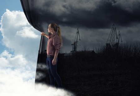 pushes: image of a young woman pushes the curtain looking at clouds