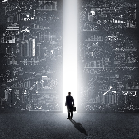 strategy decisions: Rear view of businessman standing in light of way Stock Photo