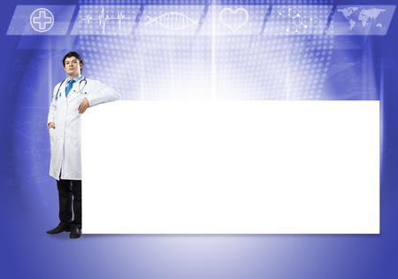 druggist: Young handsome doctor with white blank banner. Place your text