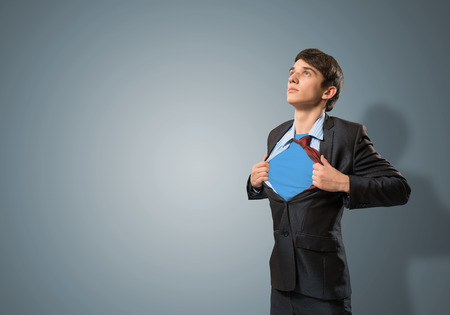 businessman tearing his shirt under her blue clothes super hero photo