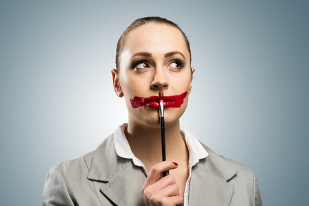desaturated: Conceptual image of a young woman with vivid red mouth Stock Photo